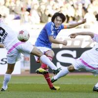 Finishing touch: Yokohama F. Marinos' Shunsuke Nakamura scores his team's second goal in a 2-0 win over Sagan Tosu in the semifinals of the Emperor's Cup on Sunday. | KYODO