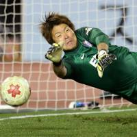 None shall pass: Sanfrecce Hiroshima goalkeeper Shusaku Nishikawa was the penalty shootout hero in his team's Emperor's Cup semifinal win over FC Tokyo on Sunday. | KYODO