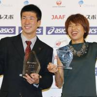 Their night to be recognized: Sprinter Yoshihide Kiryu (left) and marathon runner Kayoko Fukushi are honored at the Japan Association of Athletics Federations annual awards banquet on Tuesday. | KYODO