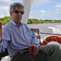 At ease: U.S. Secretary of State John Kerry talks to reporters on the Mekong River on Sunday. Along the waters that he once patrolled for communist insurgents on a U.S. Navy gunboat, Kerry turned his sights Sunday to the issue of climate change. | AP