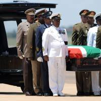 Final journey: The coffin of Nelson Mandela is carried by officers after a farewell service Saturday at Air Force Base Waterkloof in Pretoria, before its transfer to Mthatha for a traditional burial in his rural childhood home in Qunu. | AFP-JIJI
