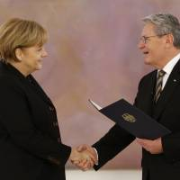 Merkel is handed third term as German chancellor