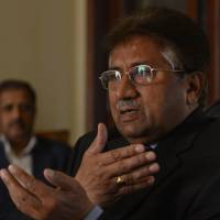 Fighting back: Pakistan's former military ruler Pervez Musharraf addresses foreign media representatives at his farmhouse in Islamabad on Sunday. | AFP-JIJI