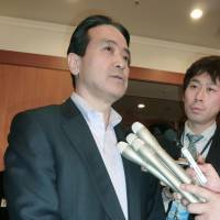 Parting ways: Kenji Eda, secretary-general of Your Party, takes questions from reporters Sunday in Tokyo about his plan to leave the opposition party and create a new one. | KYODO