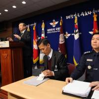 Sky's not the limit: The Director General for Policy Planning Bureau of the Ministry of Defence, Jang Hyuk (left) speaks during a press briefing announcing a new air defense zone at the Ministry of Defence in Seoul on Sunday. | AFP-JIJI