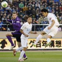 The only way is up: Tokushima Vortis defender Mitsuru Chiyotanda heads his side into the lead in Sunday's J. League promotion playoff final against Kyoto Sanga. Vortis won 2-0 to reach the first division for the first time. | KYODO