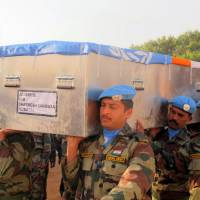 Sad Sudan: This picture taken Saturday by the U.N. Mission in South Sudan shows United Nations soldiers at a memorial ceremony carrying the coffin of one of two comrades from the Indian Battalion who were killed Thursday in Akobo, Jonglei state. | AFP-JIJI