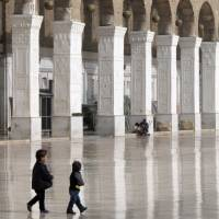 No haven: Syrian children play in the courtyard of the historic Umayyad Mosque before weekly prayers in Damascus on Friday. The mosque, one of the oldest in the world, was targeted by mortars a week earlier that killed four people amid Syria's three-year civil war. | AP