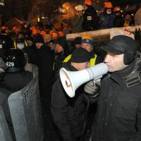 Ukraine police stand down after protest grows