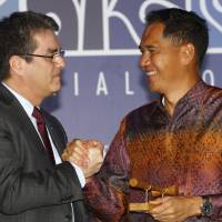 Sweet deal: World Trade Organization Director General Roberto Azevedo (left) congratulates Indonesian Trade Minister Gita Wiryawan during the closing ceremony of the ninth WTO Ministerial Conference in Bali, Indonesia, on Saturday. | AP
