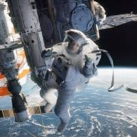 Lost in space: Sandra Bullock plays astronaut Ryan Stone in Alfonso Cuaron's new film 'Gravity.'  | © 2013 WARNER BROS. ENTERTAINMENT INC.
