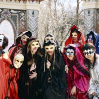 Dressed up: Masked revelers have a photo taken at the Venetian Glass Museum.