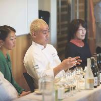 Good combination: Chefs Kunio Tokuoka (left) and Chikara Yamada (center) speak at a sake-pairing seminar in California, along with Kumiko Ninomiya (far right) of the Umami Information Center.