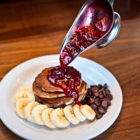 2013 in bites: U.S. import Slappy Cakes at Lumine Est in Tokyo's Shinjuku district took the pancake craze one step further this year by featuring a griddle at the table, with tempting toppings such as bananas and chocolate chips drizzled with raspberry jam.