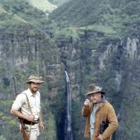 High adventure: Young Nic in the 1960s (left), during his time as Ethiopia's first-ever game warden, standing with John Bromley, a former British Consul to Eritrea, more than 3,000 meters up on the lip of Geech Abyss in the Simien Mountains, with the 800-meter Djinn Barr Falls plunging down behind them. | C.W. NICOL