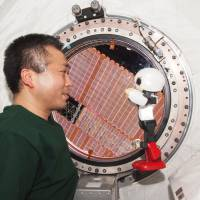 Prime time: Koichi Wakata and Kirobo hold the first-ever human-robot conversation in space, aboard the International Space Station last December. | AP/KIBO ROBOT PROJECT