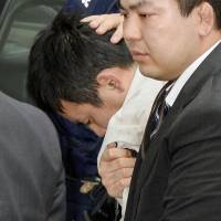 Suspect rape suspect Yuta Sugimoto is taken into custody after being captured by police at a park near Yokohama. | AP
