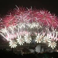 A fireworks display lights up the Harbour Bridge and the Opera House during New Year's Eve celebrations in Sydney.