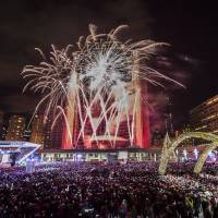 Fireworks explode during Year's Eve celebrations at Nathan Phillips Square in Toronto.