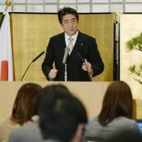 Spiritual proximity: Prime Minister Shinzo Abe speaks at a New Year's press conference in Ise, Mie Prefecture, on Monday. | KYODO