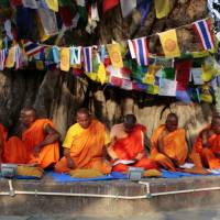 Deep roots: Monks chant at the Maya Devi Temple in Lumbini, identified as Buddha's birthplace around 200 km west of Katmandu, last April. | AFP-JIJI