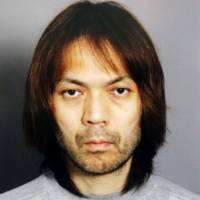 Surrender: Police release Makoto Hirata's photo Jan. 6, 2012. | AFP-JIJI