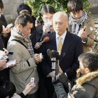 Testing the water: Former health minister Yoichi Masuzoe speaks Wednesday outside his Setagaya Ward home about his possible candidacy in the Tokyo gubernatorial election. | KYODO
