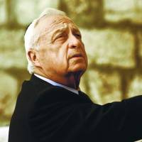 Hard-liner: Ariel Sharon, Israeli prime minister-elect at the time, touches Judaism's holiest site, the Western Wall, in Jerusalem on Feb. 7, 2001. Sharon died Saturday at age 85. | AP