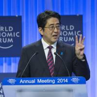 Sounding the alarm: Prime Minister Shinzo Abe addresses the World Economic Forum in Davos, Switzerland, on Wednesday. | BLOOMBERG
