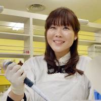 Breakthrough: Haruko Obokata, a leader of Riken's research team that discovered a new method of generating pluripotent cells, conducts an experiment. | KYODO