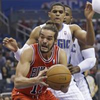 Bulls outlast Magic in 3OT