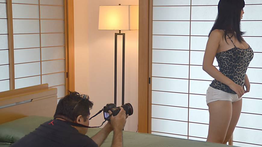 Center of attention: University student and porn actress Shiori  Tsukada poses for a picture on the set of a shoot for director Akira  Takatsuki and his Cinema Unit GAS film crew in an apartment in the  Togoshi Ginza area of south  Tokyo.