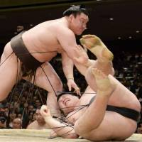 The man to beat: Yokozuna Hakuho is 5-0 in the New Year Grand Sumo Tournament after another victory on Thursday. | KYODO