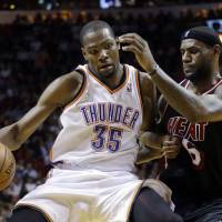 Bragging rights: Oklahoma City's Kevin Durant holds off Miami's LeBron James during the Thunder's 112-95 win on Wednesday. | AP