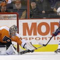 Home sweet home: Philadelphia goalie Steve Mason blocks a shot by Montreal's Daniel Briere during the Flyers' 3-1 win on Wednesday. | AP
