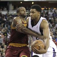 Royal flush: Sacramento's Rudy Gay (right) is fouled by Cleveland's C.J. Miles during the Kings' 124-80 win on Sunday. | AP