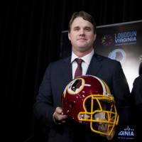 Tough assignment: Jay Gruden poses after being introduced as the new head coach of the Washington Redskins at a news conference in Ashburn, Virginia, on Thursday. | AP