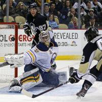 Batted away: Buffalo's Ryan Miller makes a save on a shot by Pittsburgh's Brian Gibbons in the second period on Monday. | AP