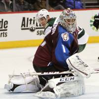 Stopped that one: Avalanche goalie Semyon Varlamov makes a save against the Wild on Thursday in Denver. | AP