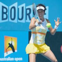 Short stay: Kimiko Date-Krumm plays a shot during her 6-4, 4-6, 6-3 loss to Switzerland's Belinda Bencic on Monday. | AFP-JIJI