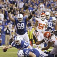 Doing it all: Indianapolis QB Andrew Luck scores a touchdown against Kansas City in the second half on Saturday. | AP