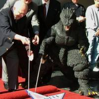 A star is born: Hollywood commemorated the 50th anniversary of Godzilla in November 2004 by awarding the beloved monster with a star on the legendary Walk of Fame. | KYODO