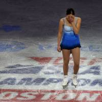 Emotions flow: Mirai Nagasu weeps as she takes the ice for the exhibition gala at the U.S. championships on Jan. 12 after learning she had been left off the 2014 U.S. Olympic team. | AP