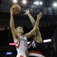 Rising star: Houston's Chandler Parsons goes up for a shot against Portland's LaMarcus Aldridge in the second half on Monday night. The Rockets beat the Blazers 126-113. | AP