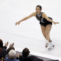 In with a chance: Mirai Nagasu lands a jump in the women's free skate at the U.S. championships in Boston on Saturday night. Nagasu finished third and will find out Sunday if she has been selected for the U.S. team for the Sochi Games. | AP