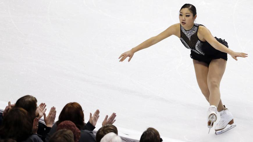In with a chance: Mirai Nagasu lands a jump in the women's free skate at the U.S. championships in Boston on Saturday night. Nagasu finished third and will find out Sunday if she has been selected for the U.S. team for the Sochi Games.