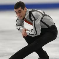 Retains crown: Spain's Javier Fernandez performs a sit spin in the free skate at the European Championships on Saturday night. Fernandez won his second straight title in the event. | AP