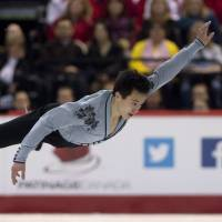 Brilliance on ice: Patrick Chan performs during the men's free program at the Canadian Skating Championships in Ottawa on Saturday. | AP