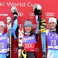 Take my hand: Mikaela Shiffrin (center) celebrates her victory with second-place Maria Pietilae-Holmner (left), and third-place finisher Nastasia Noens, on Sunday in Bormio, Italy. | AFP-JIJI