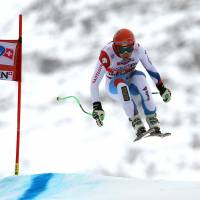 Kueng pleases home fans with victory in Wengen downhill